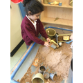 Exploring the sand pit.