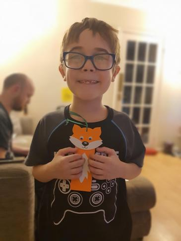 Charlie creating fox with crafts.