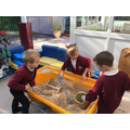 Exploring the outdoor sand pit.
