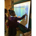 Exploring the games on the whiteboard.