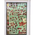 We decorated our window using Poppies to show remembrance.