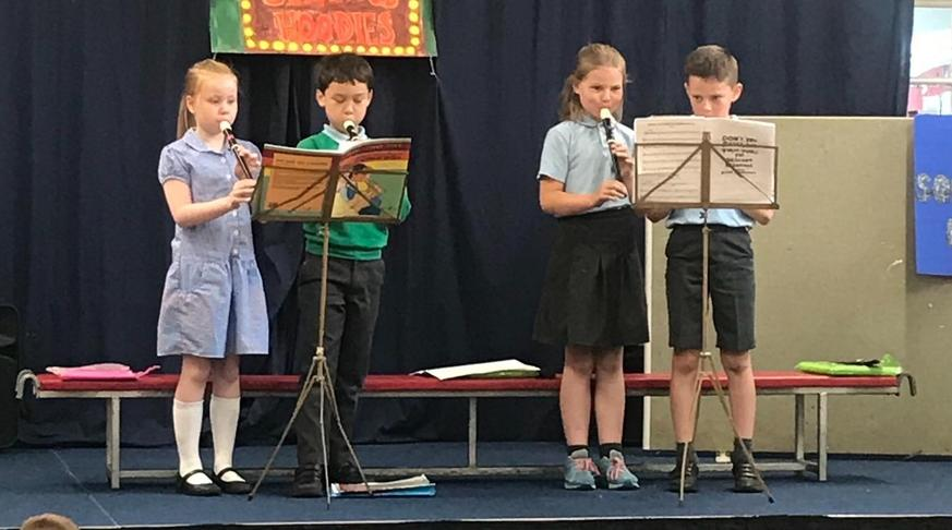 Recorder players performing in assembly