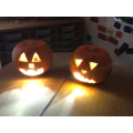 Our pumpkins in the dark! Aren't they great?!