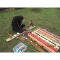 Saffron is busy working on the Bug Hotel..