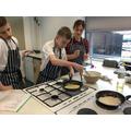Making pancakes.