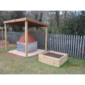 completed earth oven & flower bed....