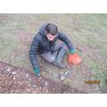 Liam is enjoying planting flower bulbs