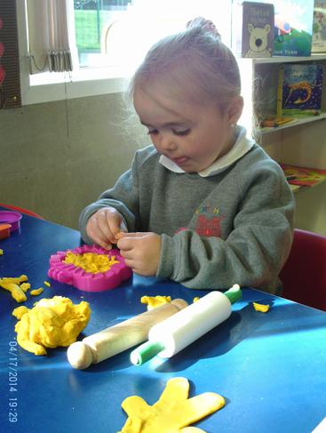 We love playdough in nursery