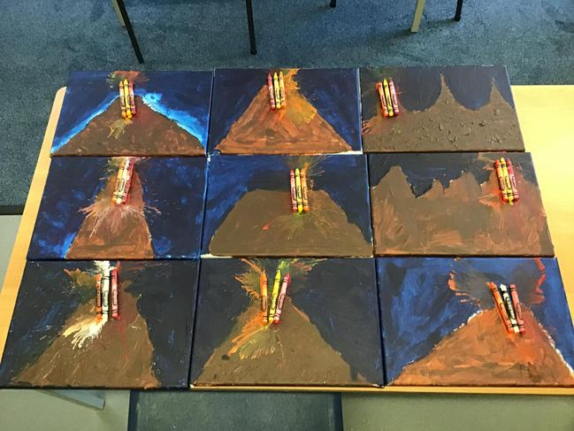 Acrylic painted volcanoes with melted crayon lava.