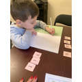 I am using my flashcards to make some words.