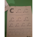 Irmas has been practising writing her letter sounds carefully.