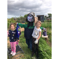 Here is our scarecrow looking after our plants.