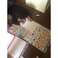 Dontaye enjoying using his new phonics chart.