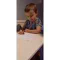 Concentrating hard on my phonics.