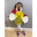 I used 4 paper plates to make my smiley bee!
