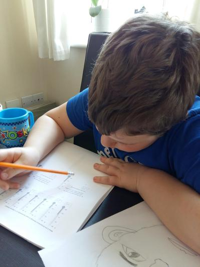 Oskar hard at work on his learning packs.