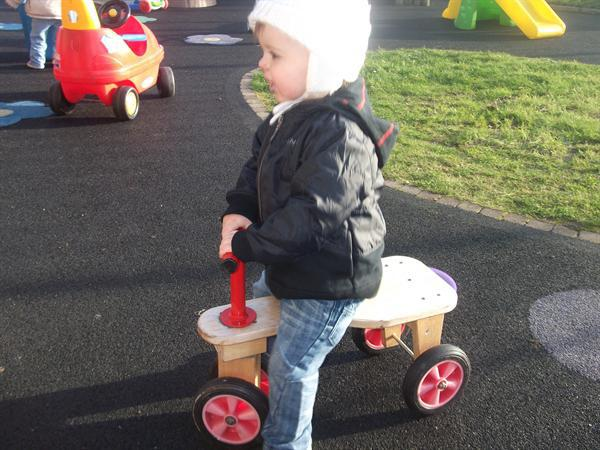 Riding the tricycle in the garden