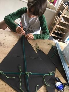 Finn making a kite for his cubs challenge