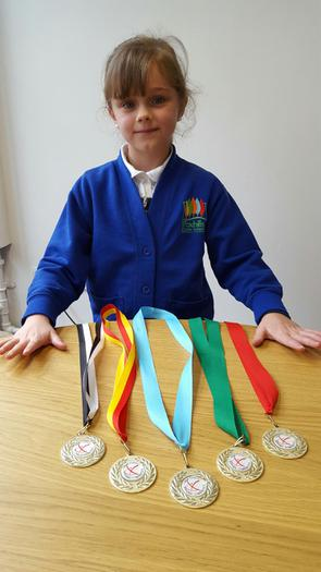 Lauren - Gymnastic awards.... LOTS of them!!