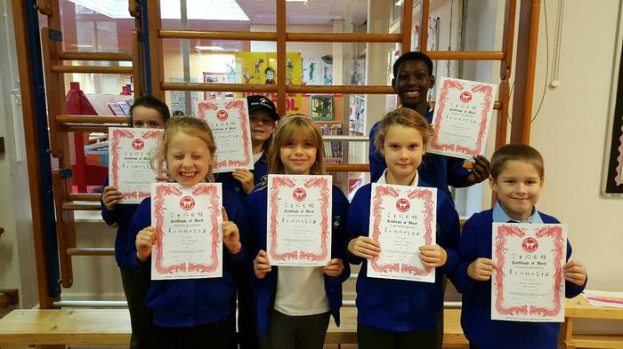 Karate certificates. Well done, everyone!