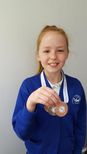 Sophie - dance medals (1st 3rd and 3rd)!