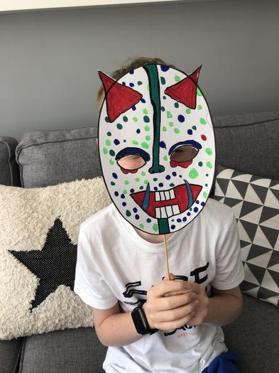 Guess who is behind the mask!