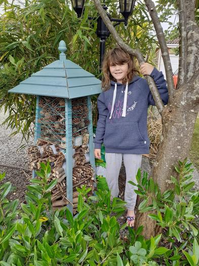 Jorja has made a bug hotel for the garden