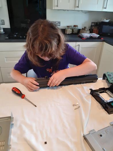 Jorja taking apart a TV and DVD player