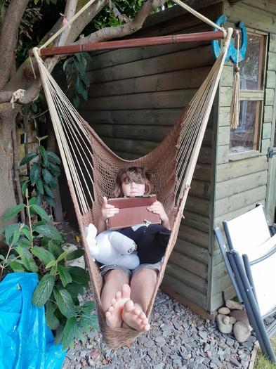Jorja relaxing for the Summer Reading Bingo task