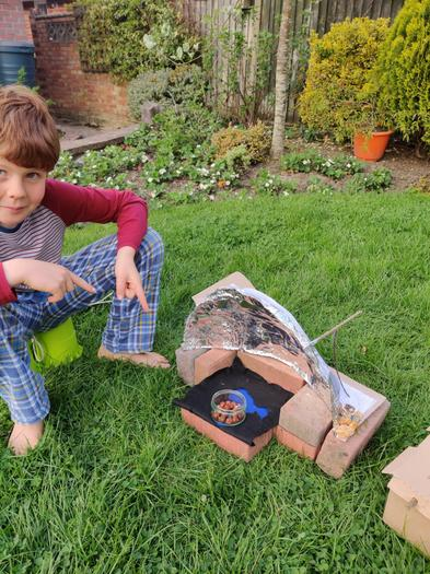 Alex made a solar oven and toasted some nuts