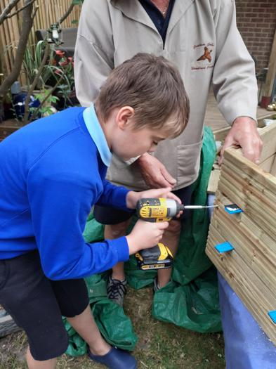 Josh helping out with some jobs in the garden