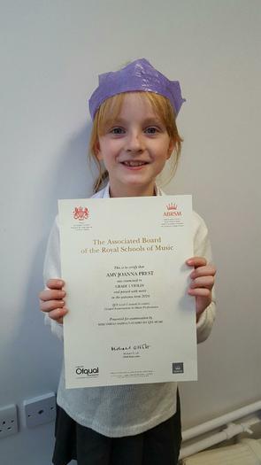 Amy Violin Award Grade 1 merit!