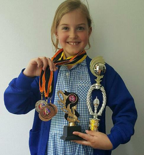 Sophia with her full stash of medals!