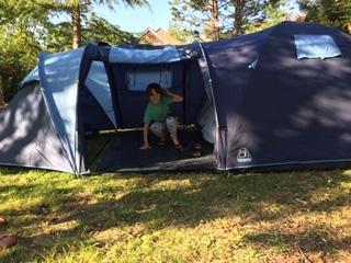 Finn having fun camping in his garden
