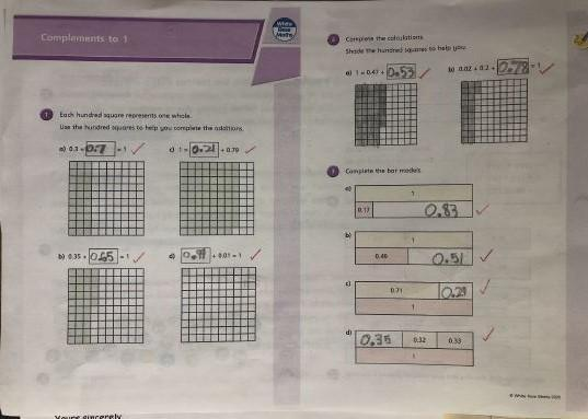 William working hard on his decimals learning