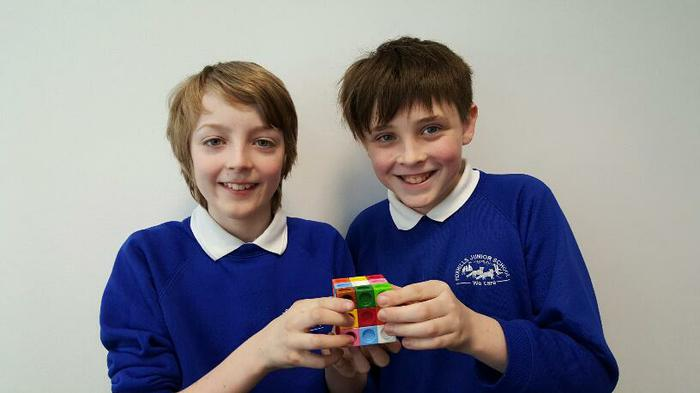 Alex and Finn.... solved the cube!