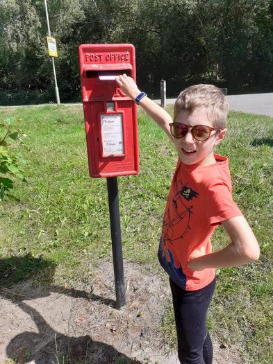 Archie posting his rainbow letter to his pen pal