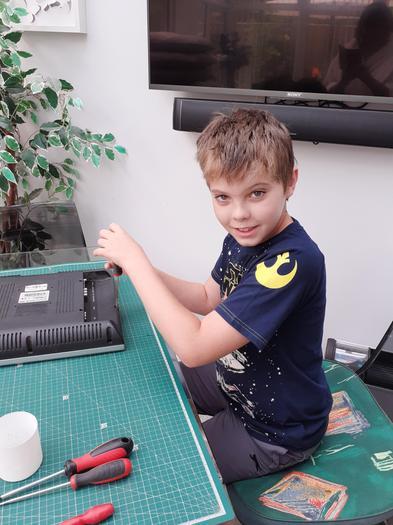 Josh taking apart a TV