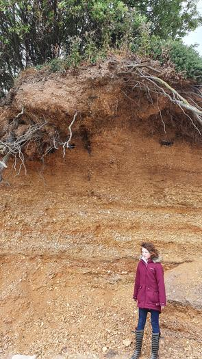 Evie studying erosion at the beach