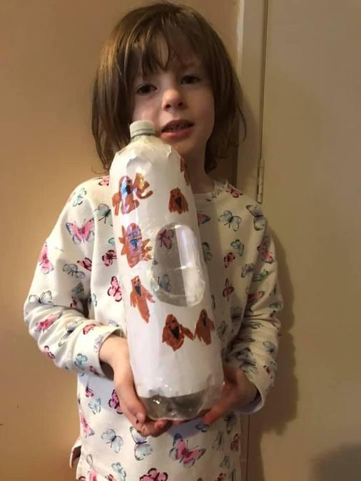 Maisie with her decorated bird feeder.