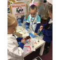 Aspiring doctors using real equipment.