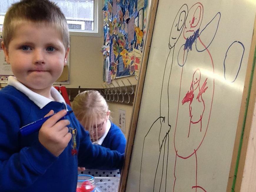 drawing on the big whiteboard