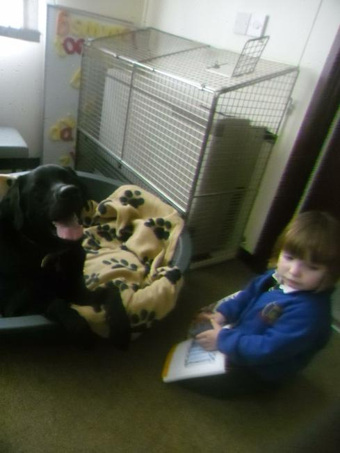 Niamh reading a story to Roko