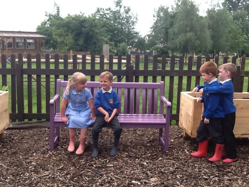 enjoying the purple bench!