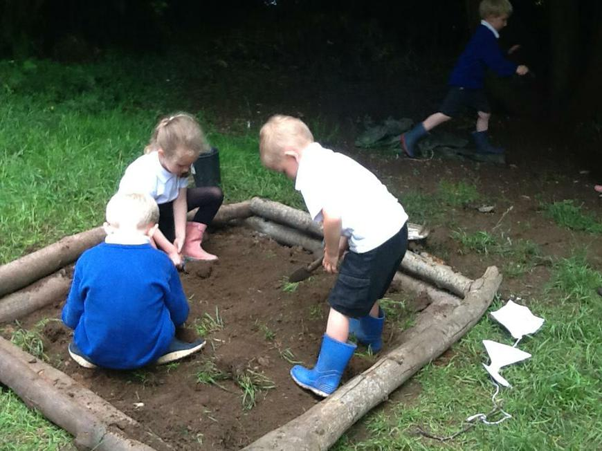 Mr Bacon and Dylan helped to make our mud pit
