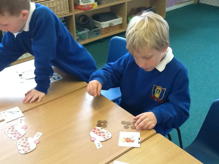 Using coins to 'buy' the currant buns