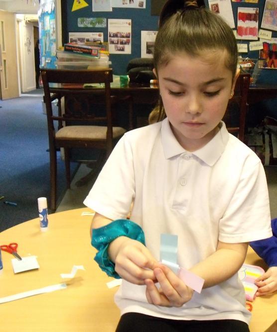 Folding a pop up concertina.
