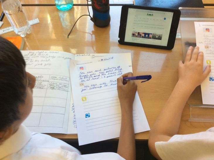 Here we are researching using I Pads.