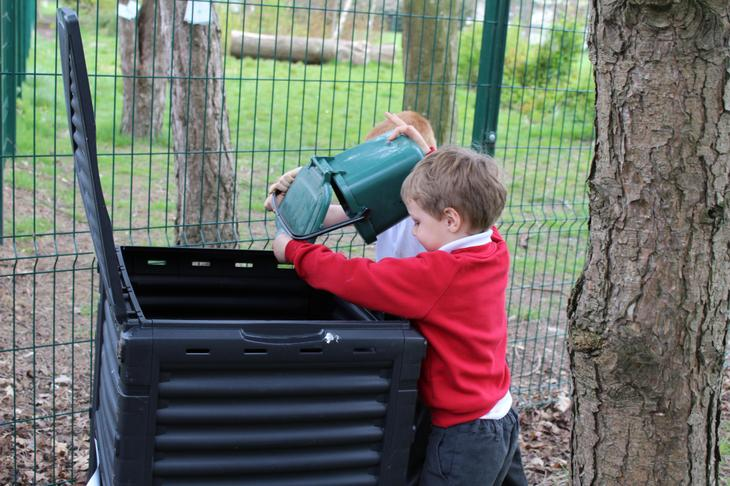 Putting fruit waste into our compost bin