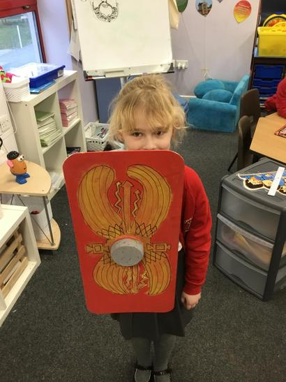Amelia made her shield from a wooden board